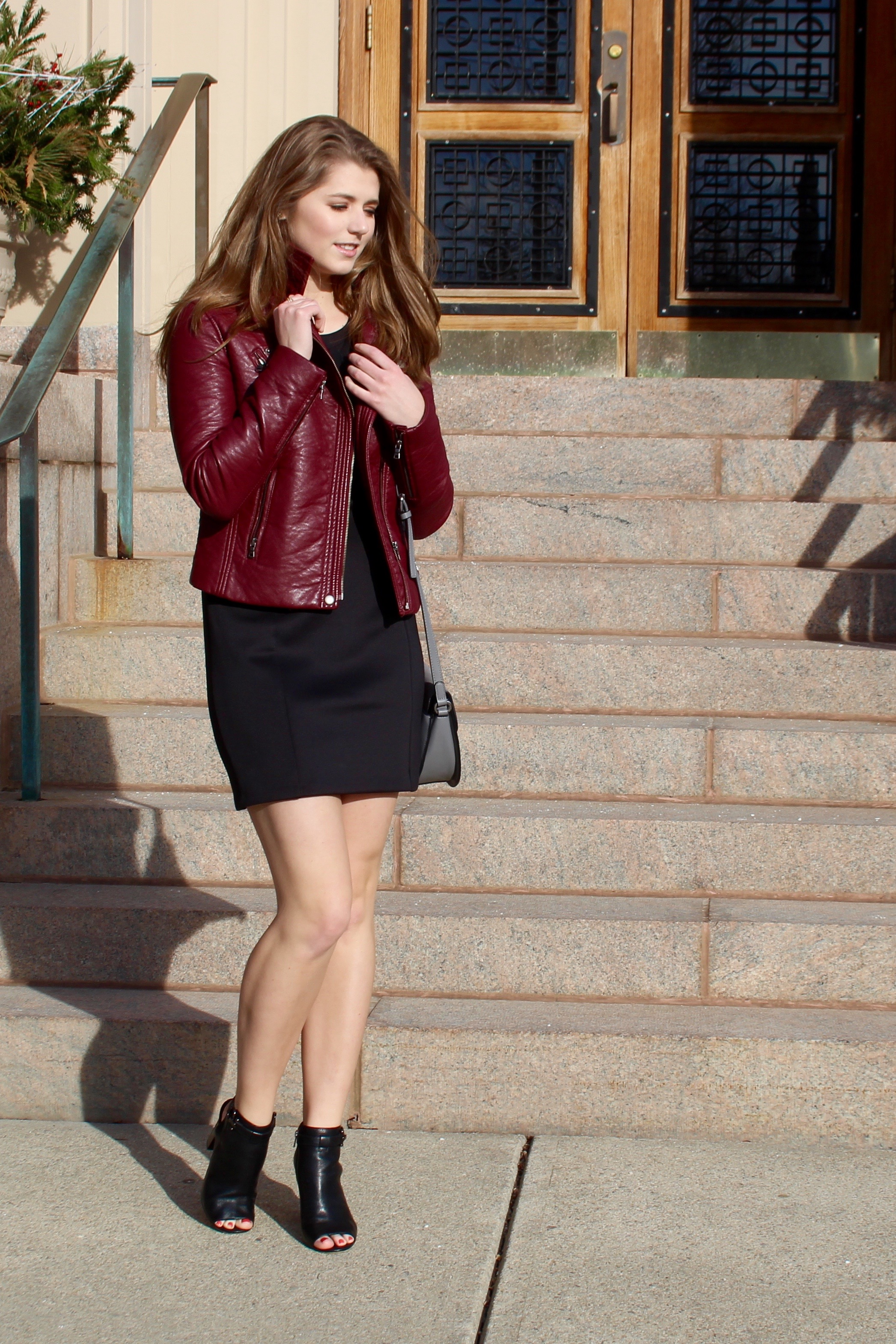 Black leather jacket with a dress